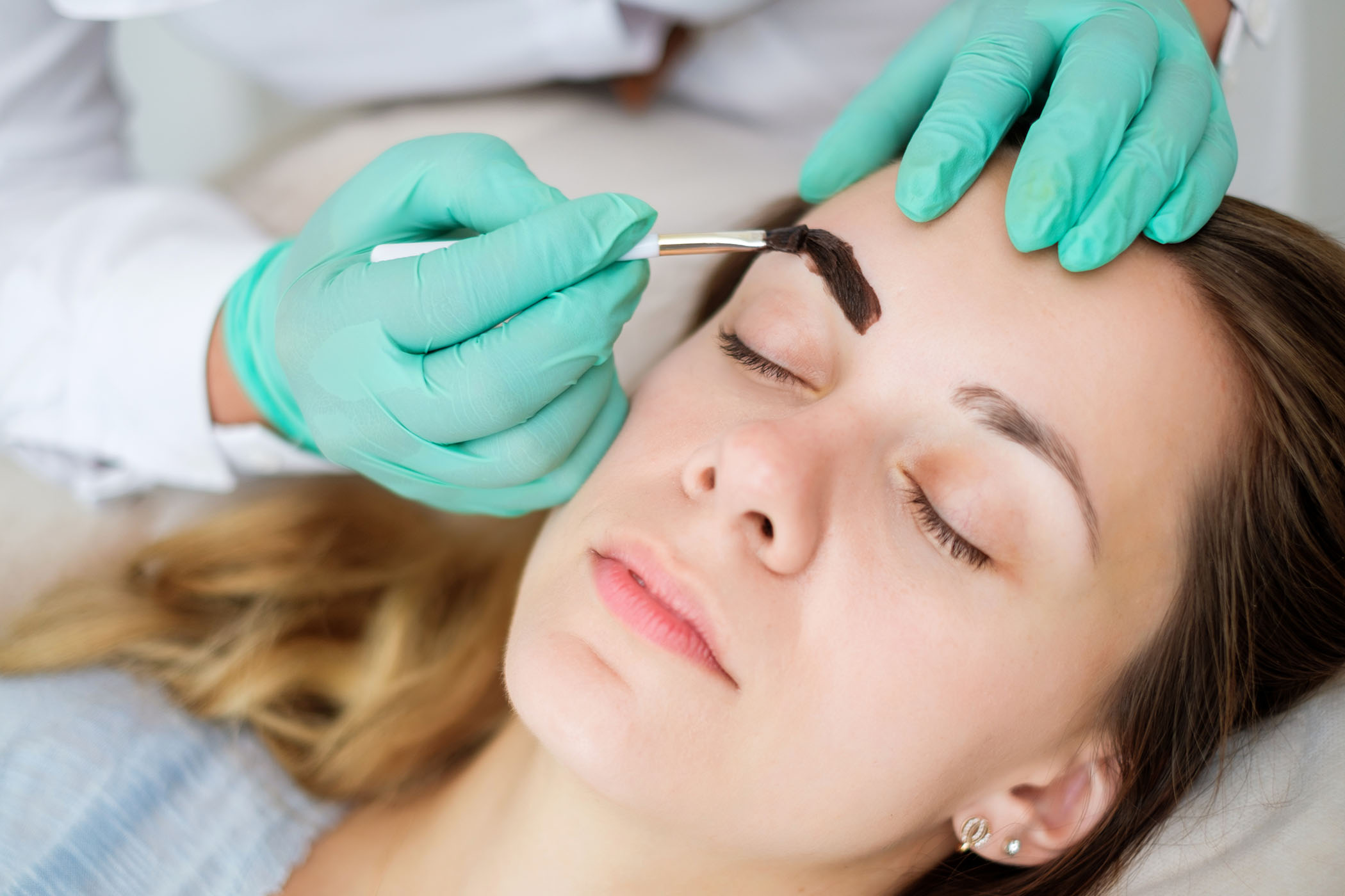 Woman having eyebrow tint in salon